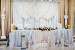 Luxury decorated main table in the wedding hall Royalty Free Stock Photo