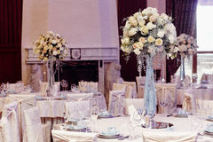 Luxury decorated tables at rich wedding reception. stylish arran Stock Photo