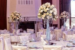 Luxury decorated tables at rich wedding reception. stylish arran Royalty Free Stock Image