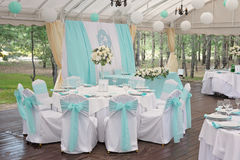 Luxury decorated tables for wedding ceremony. Staying in special place under the roof Royalty Free Stock Image