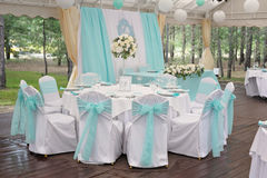 Luxury decorated tables for wedding ceremony. Staying in special place under the roof Royalty Free Stock Photography
