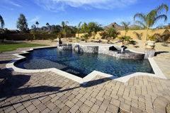 Luxury desert pool and spa. Beautiful outdoor desert pool and spa with fountains and waterfalls Royalty Free Stock Image