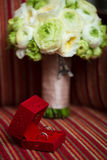 Luxury Diamond Wedding Ring in Red Velvet Silk Box Stock Photo