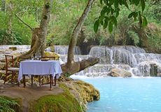 Luxury Dining in Nature at its Best with turquoise blue waterfall for special occasion royalty free stock photos