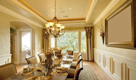 Luxury Dining Room. Ornate dining room in luxurious new home royalty free stock image