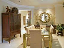 Luxury Dining Room. Ornate dining room in luxurious new home stock images