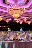 luxury dining room and crystal chandelier Stock Images