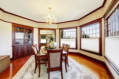 Luxury dining room with wood trim and built-in cabinet. Decorated family dining table stock images
