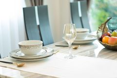 Luxury dining table decor at home. Interior at dining room at home concept stock photography