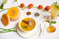Luxury dinner from soup and tea prepared in restaurant. royalty free stock photography