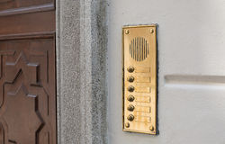 Luxury door intercom and bell buttons in brass Stock Photo