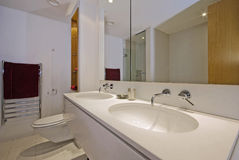 Luxury double bath room. Contemporary family bathroom with double hand wash basin Royalty Free Stock Photo