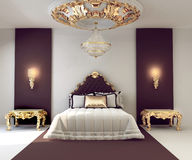 Luxury double bedroom with golden furniture Royalty Free Stock Image