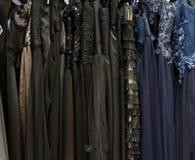 Luxury dresses. Black and dark luxury dresses background stock photos