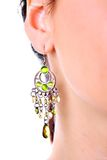 Luxury earring in young girl ear. Closeup stock image