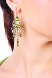 Luxury earring in young girl ear Stock Image