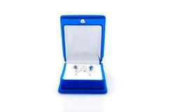 Luxury earrings in blue velvet jewelry box Royalty Free Stock Image