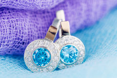 Luxury earrings with zircon and blue gemstones Stock Photography