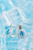 Luxury earrings with zircon and blue gemstones Stock Photos