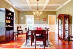 Luxury elegant green dining room with cherry floor. Royalty Free Stock Image