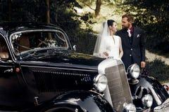 Luxury elegant wedding couple holding hands on background of sty Stock Photo