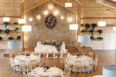 Luxury, elegant wedding reception table arrangement, floral centerpiece. Look from afar at luxurious restaurant hall prepared for wedding dinner Stock Photo