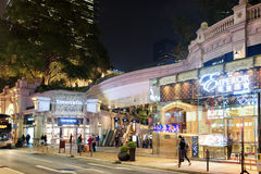Luxury elite stores on streets of night city Hong Kong Stock Photo