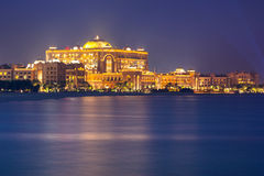 Luxury Emirates Palace hotel in Abu Dhabi at night Royalty Free Stock Photo
