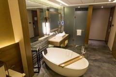 Luxury ensuite 5 star bathroom in bedroom Royalty Free Stock Photos