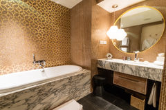 Luxury ensuite 5 star bathroom in bedroom Royalty Free Stock Images