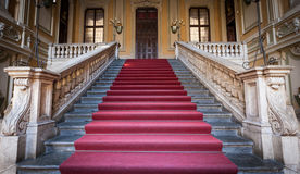 Luxury entrance. Red carpet for this Italian old palace entrance Stock Images