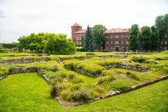 Luxury estate with big green garden. Elite apartments concept. Estate for aristocracy or old castle in Krakow. Castle. With tower made out of red brick royalty free stock photography