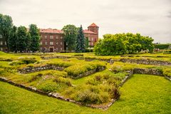 Luxury estate with big green garden. Elite apartments concept. Estate for aristocracy or old castle in Krakow. Castle. With tower made out of red brick royalty free stock photos