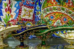Turkish souvenir tea pot magic lamp. Luxury expencive tea pot set of silver with ornaments sold on the Grand Bazaar in Istanbul, Turkey Royalty Free Stock Image
