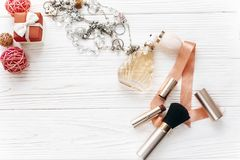 Luxury expensive jewelry and make up essentials and perfume flat. Lay on white rustic wooden table with space for text.  fashion blogger. modern woman set of Royalty Free Stock Image