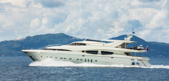 Luxury and expensive motor yacht in the sea or blue ocean. Stock Photos