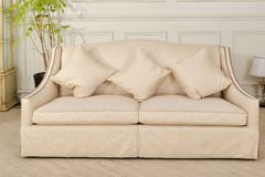 Luxury fabric sofa in living room royalty free stock images