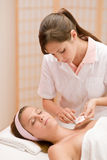 Luxury facial care - woman in spa salon Stock Photography