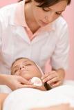 Luxury facial care - woman in spa salon Stock Photos