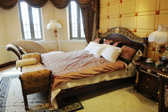 The luxury family bedroom. With double bed,lamps,couch and other furniture Stock Image