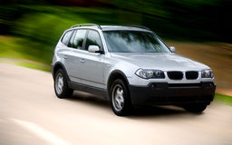 Luxury family car on a road Stock Photography