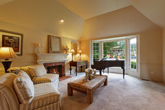 Luxury family room with grand piano and fireplace Royalty Free Stock Images