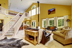 Luxury family room with rich furniture and staircase to loft Stock Photography