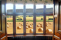 Luxury farmhouse living. Photo of luxury farmhouse bay window overlooking a field of hay bales in the county of kent Stock Photography