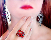 Luxury fashion make-up manicure jewelry ring and earrings Stock Images