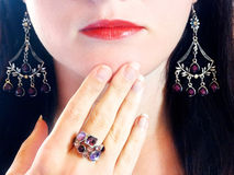 Luxury fashion make-up manicure jewelry ring and earrings Royalty Free Stock Photography