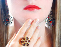 Luxury fashion make-up manicure jewelry ring and earrings Stock Image