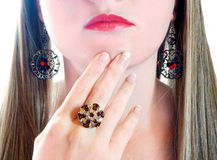 Luxury fashion make-up manicure jewelry ring and earrings Stock Photography