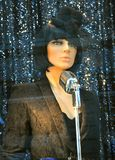 Luxury fashion mannequin in Italy. High fashion boutique in Italy. Luxury brand window shop with female mannequins. a woman as a singer with vintage microphone Royalty Free Stock Photo