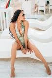 Luxury fashion sexy bikini model on sunbed chill out Stock Photos